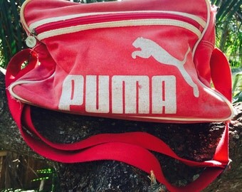 Vintage 80s distressed canvas puma bag