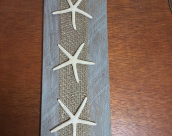 Starfish on blue/grey reclaimed wood with burlap back
