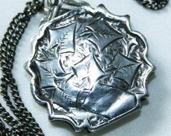 Antique Victorian Silver Locket c1877.   Engraved on front and Back. Heavy for size