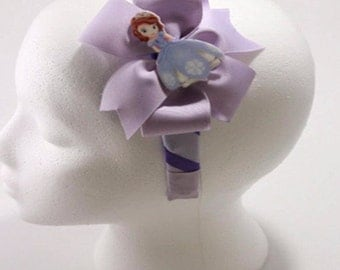 Sofia the First  is the main features in this Purple and Lilac headband