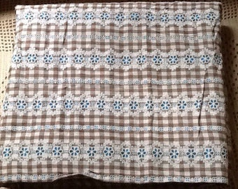 Retro, Flocked Brown Gingham with turquoise flowers.  2 yards 16 inches