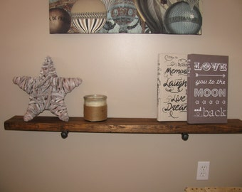 Wood shelf with industrial pipes