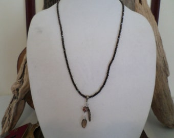 smokey topaz briolette hanging with a feather and crystal, chocolate beaded necklace