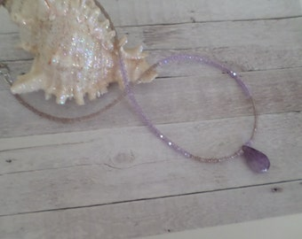 light lavender seed beads with an amethyst tear drop pendant