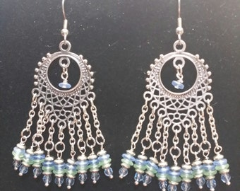 Silver chandelier earrings with green and blue beading