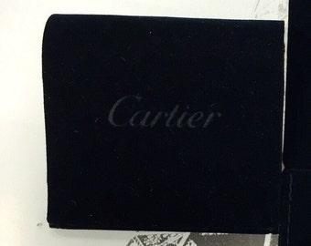 CARTIER velvet bag again .