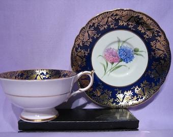PARAGON TEACUP/SAUCER (England) -  Pink & Blue Cornflowers on Cobalt Blue with Gold Trim, Patt# A1979,    c.1950's