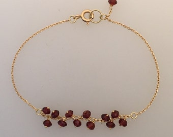 Solid 18k yellow gold chain friendship bracelet with tiny faceted garnets