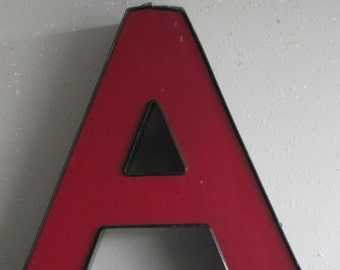 Channel Sign Letter Capital 'A' in red/purple with Black Trim