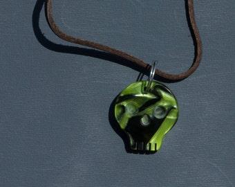 Toxic green skull pendant