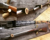 Custom Barn wood Gun Rack with branches for stock and barrel supports.