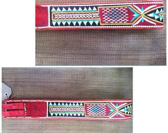 Vintage multi-colored weaved leather belt.