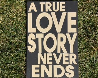 A True Love Story Never Ends Wooden Painted Sign