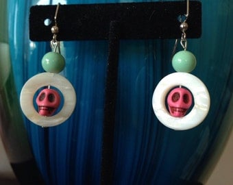 Art Deco Miami style aqua blue, shiny shells and pink skulls dangle earrings.