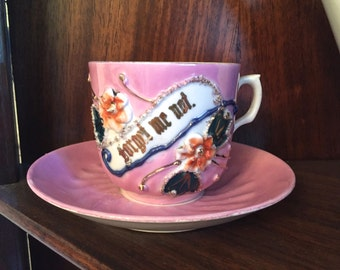 "Circa late 1800's ""Forget me Not"" pink remembrance cup and saucer with raised flowers and gilding-made in Germany"