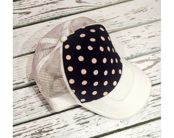 New black with light pink polka dot limited edition design, available on a variety of different colored brims.