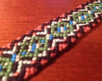 Autumnal friendship bracelet: orange-black-green-blue-yellow