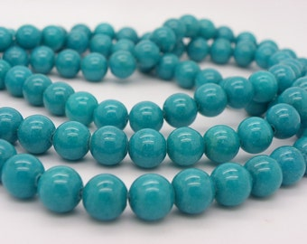 47 to 48 beads jade 8 mm a beautiful shade of blue-green hole 1.2