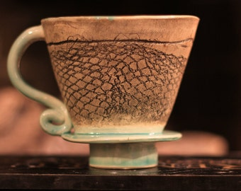 Hand-built pour-over coffee maker with beautiful texture and celadon blue glaze