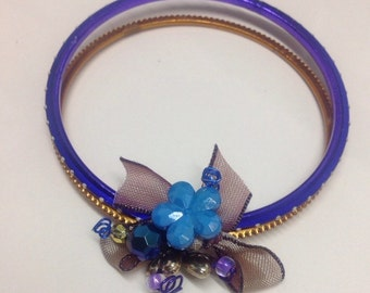 Ladies embellished double bangle.  Blue and gold featuring a blue flower.  A16BAN05