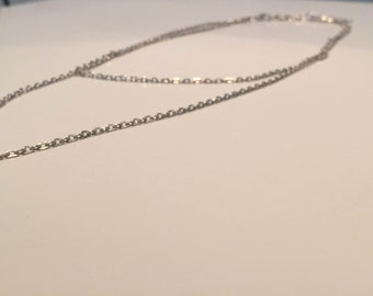 Necklace with double layer chain and simple pearl gem