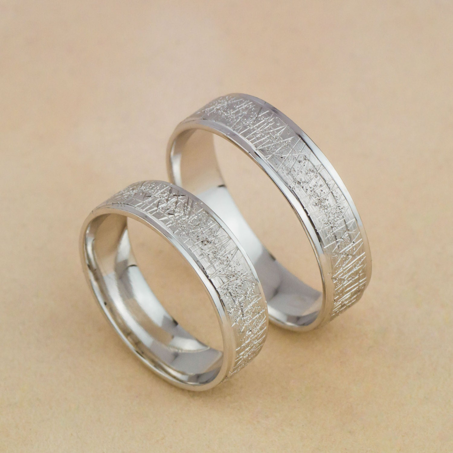 wedding bands in 14k white gold with unique scratches and