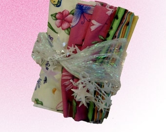 8 fat quarters Fairy fabric in pink, white, yellow, green, pink, teal, and purple