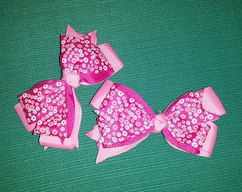 Pair of small pink flower print hair bows
