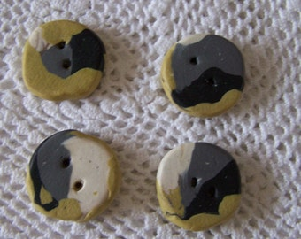 Four hand made clay buttons