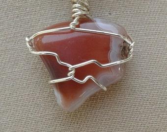 Orange and white jasper pendant