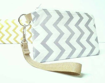 Shiny silver and white chevron bag/wristlet/pouch/handbag with a white and silver sparkle lining and a gold flecked sparkle strap