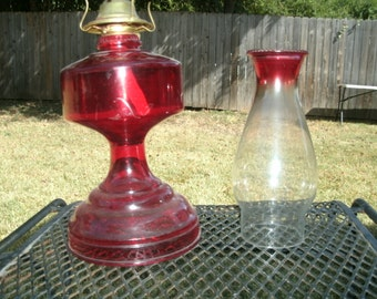 Vintage hurricane lamp in ruby red color