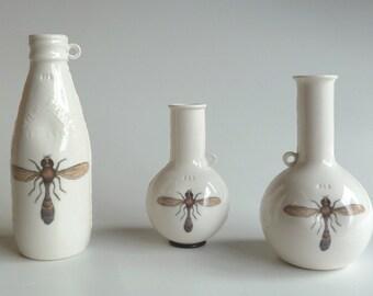 Porcelain milk bottle and specimen bottle pourers/jugs