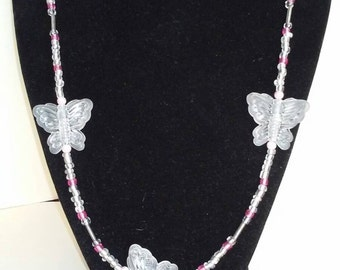butterfly clear bead necklace with pink accent