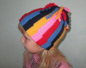 Cheerful striped cap with original bubo crocheted for girls. Handmade.