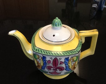 Vintage Japanese ceramic teapot in bright yellow with a fun dragon design hand painted. Art Deco Japanese folk art teapot from 1930s.