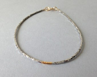 Simple gold and silver layering bracelet / Delicate friendship bead bracelet / Gold and silver
