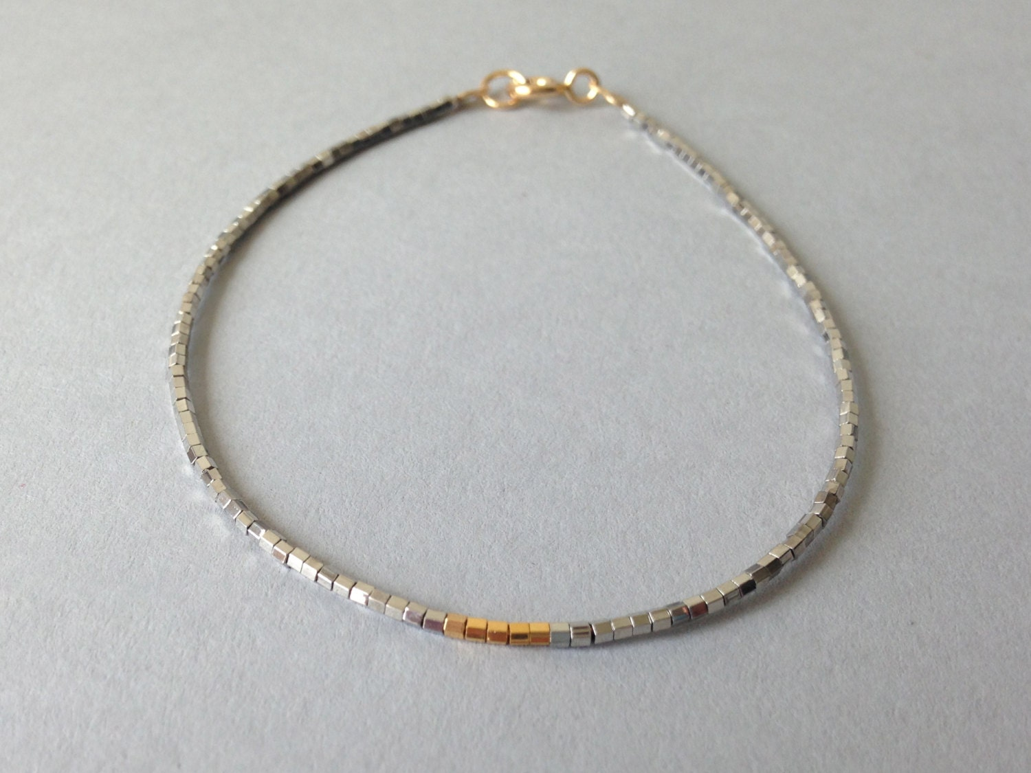 Simple gold and silver layering bracelet / Delicate friendship