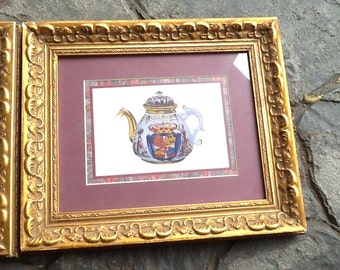 SALE!!! PAIR of vintage (c.1980s) heavy gilt-framed and matted prints of a fancy Imari teapot and tea cup.  Signed V. Morland. MINT!
