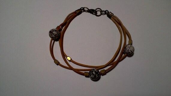 tan leather bracelet made of brass and Leopardskin Jasper beads