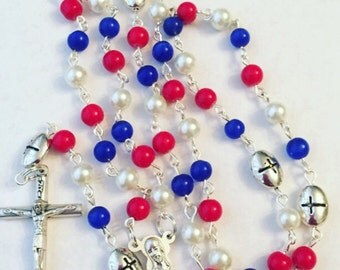Red, white, blue. Patriotic.  Catholic rosary, prayer beads, rosary beads. Fourth of July. 4th of July. Independence Day. America. USA