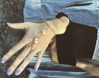 Gold finger bracelet