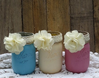 Set of three mason jars with twine, lace, and flower