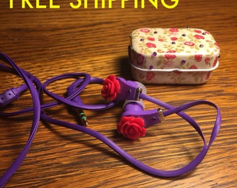 Purple floral earbuds with tin carrier