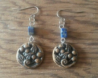 These earrings. Clay. BERRY