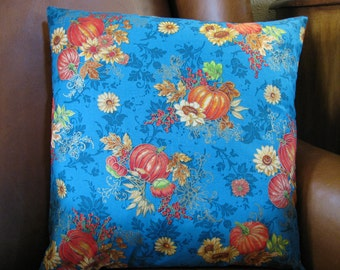 """16""""x16""""  Gorgeous teal fall pillow cover is stunning, a background in rich teal, with vivid bursts of orange pumpkins and sunflowers."""