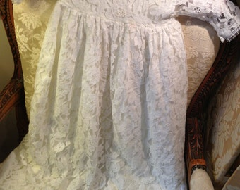 19ins chestx28 length long lace baby dress. Opens down the back. Vintage.