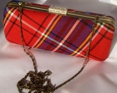 Red and purple tartan clutch bag with chain