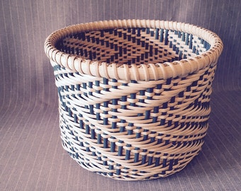 Handwoven basket with wood base and switchback pattern