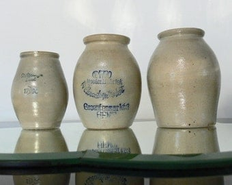 Tierenteyn set of three mustard pots from Ghent , Belgium in glazed stoneware .